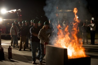 CERT training participants approaching the fire